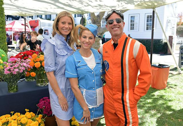<p>Paltrow (not in costume) joined the comedian and his wife at the GOOD+ Foundation Halloween Bash on Sunday. Jessica, who is the founder of the organization to help impoverished children, dressed as a '50s diner waitress, while her hubby sported a racing suit and goggles. (Photo: Neilson Barnard/Getty Images for GOOD+ Foundation) </p>