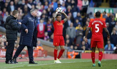 Britain Football Soccer - Liverpool v Crystal Palace - Premier League - Anfield - 23/4/17 Liverpool's Nathaniel Clyne prepares to take a throw in while Crystal Palace manager Sam Allardyce gestures Reuters / Phil Noble Livepic