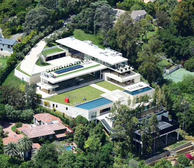 Beyoncé and JAY-Z have finally found a permanent home in Los Angeles after paying $88 million for this Bel Air mansion. (Photo: Splash News)