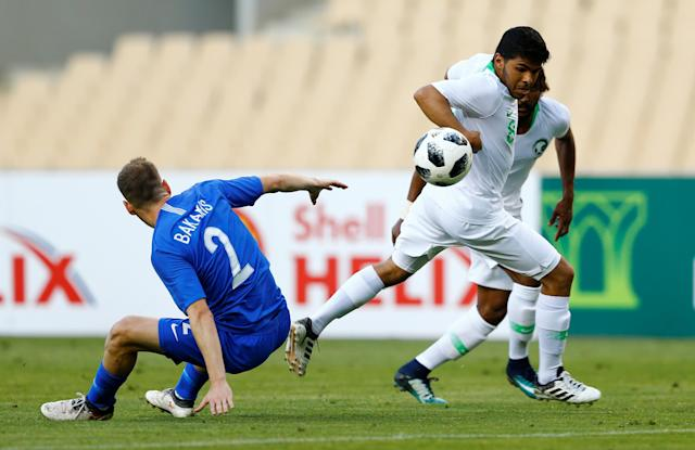 Soccer Football - International Friendly - Saudi Arabia v Greece - Estadio de La Cartuja, Seville, Spain - May 15, 2018 Saudi Arabia's Yahya Al-Shehri in action Greece's Michail Bakakis REUTERS/Marcelo Del Pozo