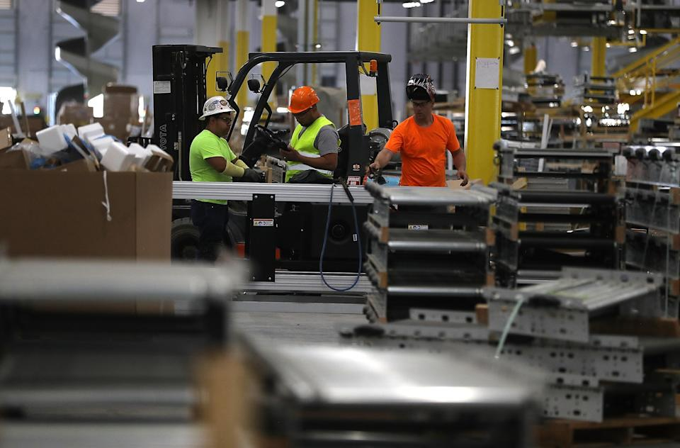Workers view a conveyor belt system that is under construction at a new Amazon fulfillment center on August 10, 2017 in Sacramento, California. (Photo by Justin Sullivan/Getty Images)