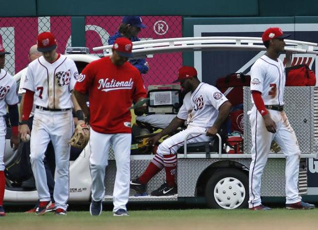 Washington Nationals outfielder Howie Kendrick is carted off the field after suffering a strange and potentially serious leg injury. (AP)