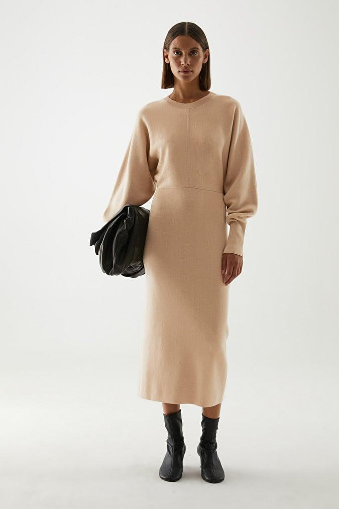 <p>I love the silhouette of this <span>Organic Cotton-Wool Mix Knitted A-Line Dress</span> ($125).</p>