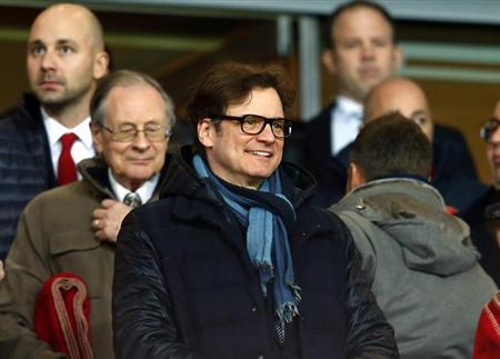 British actor Firth attends the Champions League round of 16 first leg soccer match between Arsenal and Bayern Munich at the Emirates Stadium in London