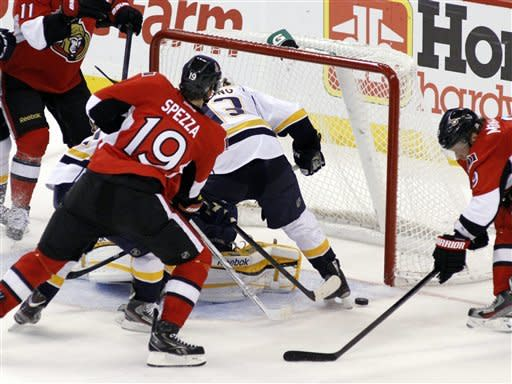 Ottawa Senators' Jason Spezza (19) scores past Nashville Predators goalie Pekka Rinne as Predators' Nick Spaling defends during second-period NHL hockey action in Ottawa, Ontario, Thursday, Feb. 9, 2012. (AP Photo/The Canadian Press, Fred Chartrand)
