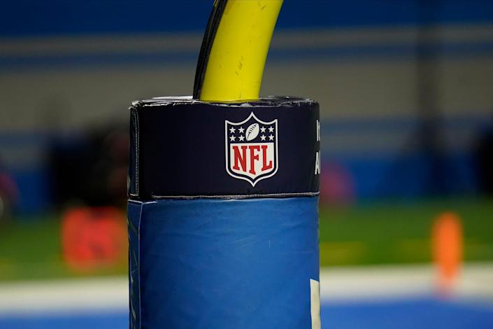 An NFL logo is shown on the goal post during the first half of an NFL football game between the Detroit Lions and Houston Texans, Thursday, Nov. 26, 2020, in Detroit.