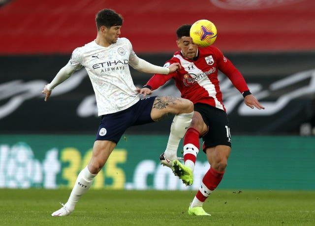 Manchester City's John Stones and Southampton's Che Adams (right) could come face-to-face at Wembley (