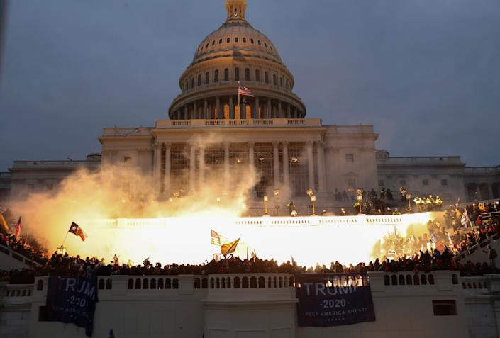 An explosion caused by a police munition is seen while supporters of U.S. President Donald Trump gather in front of the U.S. Capitol Building. (Leah Millis/Reuters)