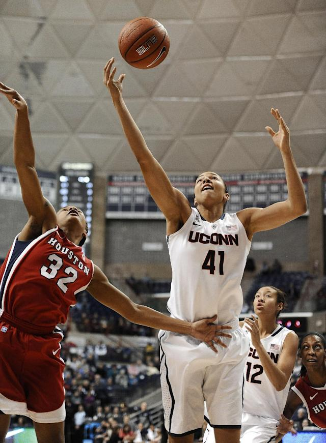 Connecticut's Kiah Stokes (41) reaches for a rebound over Houston's Te'onna Campbell (32) during the first half of an NCAA college basketball game, Tuesday, Jan. 7, 2014, in Storrs, Conn. (AP Photo/Jessica Hill)