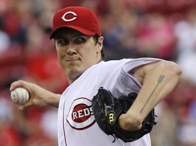 Cincinnati Reds starting pitcher Homer Bailey throws against the St. Louis Cardinals in the first inning of a baseball game, Friday, May 23, 2014, in Cincinnati. (AP Photo/Al Behrman)