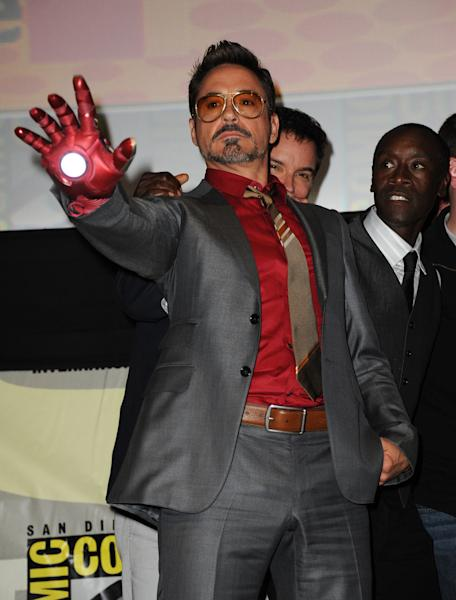 """Robert Downey Jr. poses at the """"Iron Man 3"""" panel 2012 Comic Con on Saturday, July 14, 2012 in San Diego, Calif. (Photo by Jordan Strauss/Invision/AP)"""