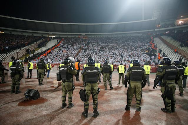Soccer Football - Europa League - Red Star Belgrade vs FC Cologne - Rajko Mitic Stadium, Belgrade, Serbia - December 7, 2017 General view of police stood in front of cordoned off Cologne fans REUTERS/Novak Djurovic