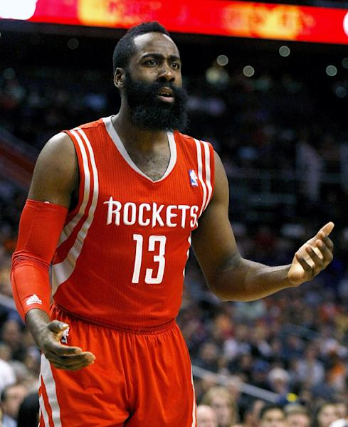 Houston Rockets shooting guard James Harden (13) reacts to a no call in the first quarter during an NBA basketball game against the Phoenix Suns, Sunday, Feb. 23, 2014, in Phoenix. (AP Photo/Rick Scuteri)