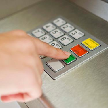 Person-pushing-buttons-at-atm_web
