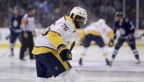 Nashville Predators' P.K. Subban (76) jokes with goaltender Pekka Rinne (35) who is sitting in the tunnel prior to first period NHL hockey action against the Winnipeg Jets' in Winnipeg, Sunday, March 25, 2018. (Trevor Hagan/The Canadian Press via AP)