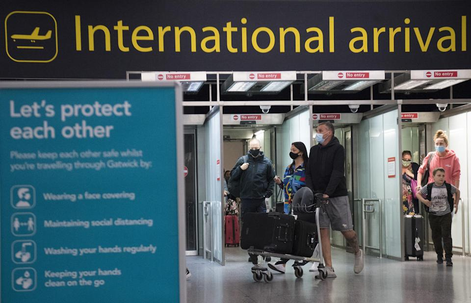 Passengers arriving at Gatwick Airport (Kirsty O'Connor/PA) (PA Wire)