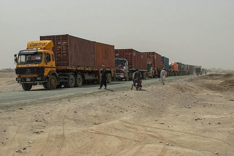 Trucks carrying goods destined for Afghanistan's second biggest city line up near Chaman, in Pakistan, waiting to cross the border. Traders say they are being taxed by the Taliban as well as Afghan government officials, and also face extortion or robbery from highway bandits