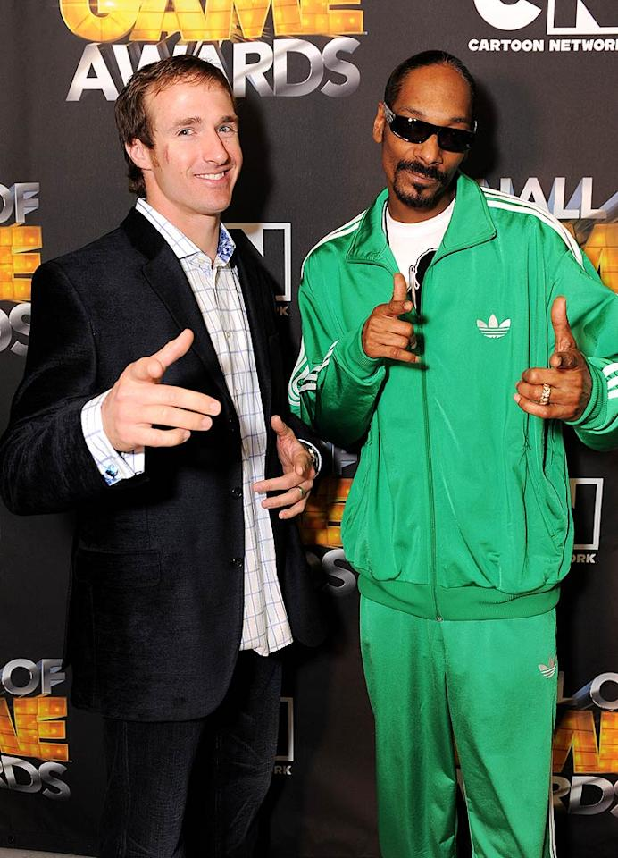 "New Orleans Saints quarterback Drew Brees struck a pose with none other than Snoop Dogg. Nice tracksuit Snoop! Jordan Strauss/<a href=""http://www.wireimage.com"" target=""new"">WireImage.com</a> - February 21, 2011"