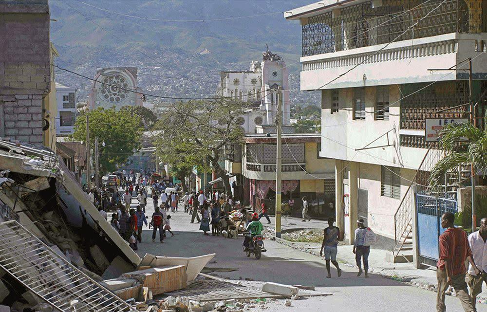 These images show a street in Port-au-Prince on Jan. 14, 2010, two days after the earthquake and the same street on Dec. 29, 2014.