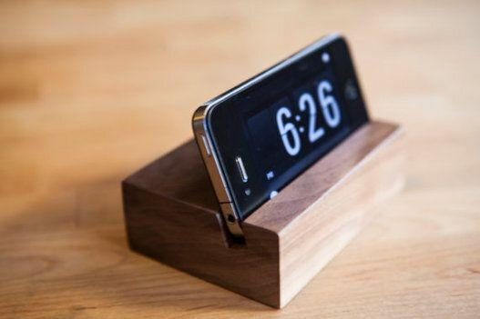 """<a href=""""https://www.etsy.com/ca/listing/152733620/iphone-stand-wood-tech-gift-gifts-for"""" target=""""_blank"""">iPhone Stand, $15.76, available at Etsy </a>"""