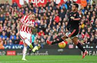 Stoke City's striker Marko Arnautovic (L) shoots past Manchester United's midfielder Memphis Depay to score their second goal during an English Premier League football match on December 26, 2015 (AFP Photo/Paul Ellis)