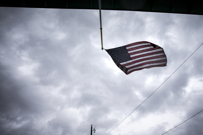 An American flag flaps in the wind after part of it broke loose from its pole on a house as the rain bans from Hurricane Dorian still linger over Tybee Island, Ga. on Sept. 5, 2019. (Photo: Stephen B. Morton/AP)