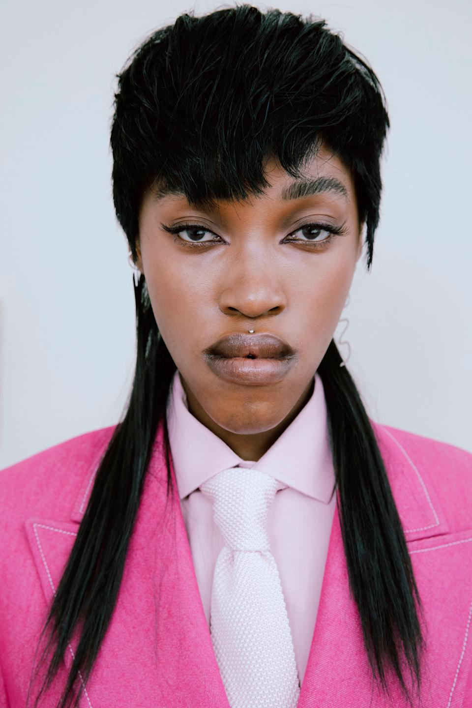 """Like many mullets, the style seen at <a href=""""https://www.allure.com/gallery/paris-fashion-week-fall-2021-hair-makeup-trends?mbid=synd_yahoo_rss"""" rel=""""nofollow noopener"""" target=""""_blank"""" data-ylk=""""slk:Thebe Magugu's fall 2021"""" class=""""link rapid-noclick-resp"""">Thebe Magugu's fall 2021</a> show has a ton of texture, but it is brought out through the actual cut of the hair, as opposed to a natural pattern. Here, the hair in the back flows straight down, instead of bending or curling. """"For a more full face, the modern mullet is the way to go,"""" notes hairstylist <a href=""""https://www.instagram.com/sallyhershberger/"""" rel=""""nofollow noopener"""" target=""""_blank"""" data-ylk=""""slk:Sally Hershberger"""" class=""""link rapid-noclick-resp"""">Sally Hershberger</a>. """"The hair framed around the face will perfectly complement this face shape."""""""