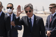 Secretary of State Antony Blinken waves as he steps off his plane upon arrival at Cairo International Airport, Wednesday, May 26, 2021, in Cairo, Egypt. (AP Photo/Alex Brandon, Pool)