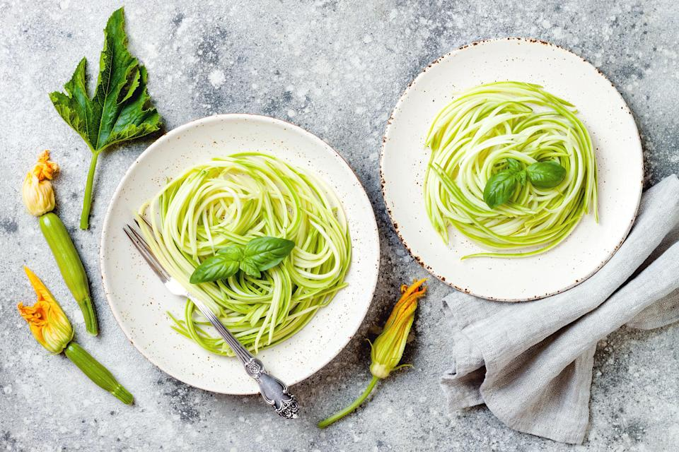 Zucchini spaghetti with basil. Vegetarian vegetable low carb pasta. Zucchini noodles or zoodles