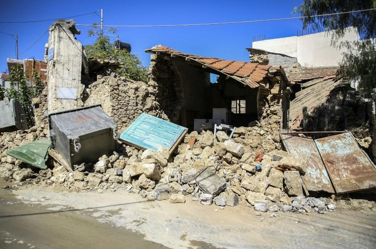 The quake damaged buildings and sent panicked residents rushing into the streets (AFP/Costas Metaxakis)