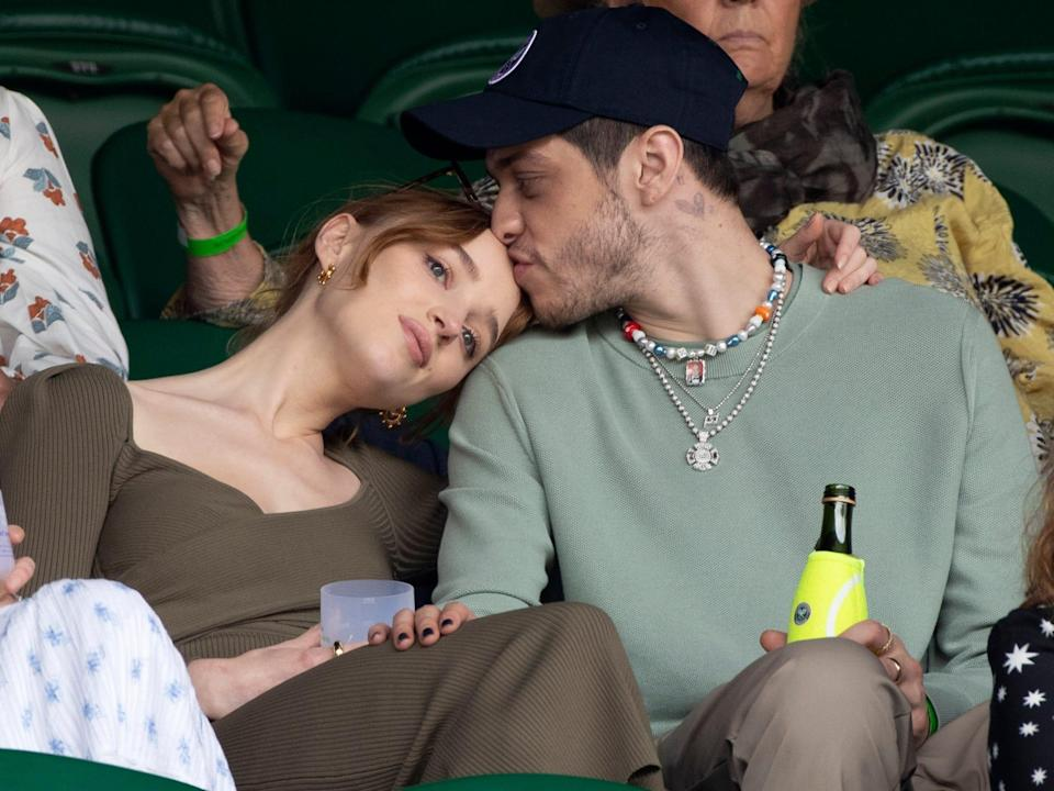 Phoebe Dynevor leaning her head on Pete Davidson's shoulder while in attendance at Wimbledon in July 2021.