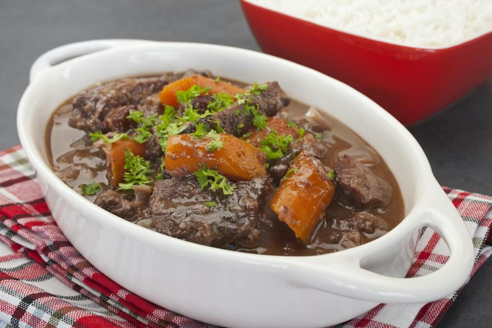 """<p>This French-style beef stew is the perfect way to settle down after a long day of working. It's good to know a <a href=""""https://www.thedailymeal.com/cook/15-basic-cooking-methods-you-need-know-slideshow?referrer=yahoo&category=beauty_food&include_utm=1&utm_medium=referral&utm_source=yahoo&utm_campaign=feed"""" rel=""""nofollow noopener"""" target=""""_blank"""" data-ylk=""""slk:basic cooking method"""" class=""""link rapid-noclick-resp"""">basic cooking method</a> for this recipe, like how to sear so you can get that browned, tender beef that this dish requires. This stew is slow-cooked with a vegetable medley in a brown sauce that is great to serve over pasta or mashed potatoes.</p> <p><a href=""""https://www.thedailymeal.com/best-recipes/beef-daube-provencal?referrer=yahoo&category=beauty_food&include_utm=1&utm_medium=referral&utm_source=yahoo&utm_campaign=feed"""" rel=""""nofollow noopener"""" target=""""_blank"""" data-ylk=""""slk:For the Beef Daube Provencal recipe, click here."""" class=""""link rapid-noclick-resp"""">For the Beef Daube Provencal recipe, click here.</a></p>"""