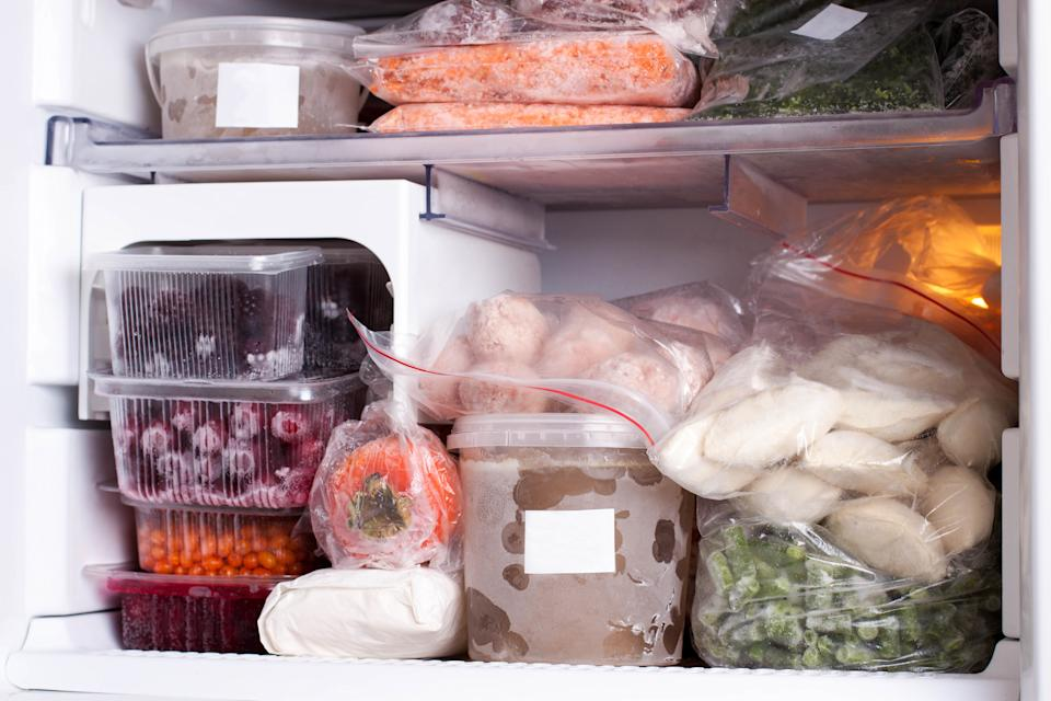 Assortment of frozen vegetables, meat and dumplings in home fridge