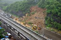 Heavy rains cause landslide at the Western Express Highway near Kandivali. (Photo by Arun Patil)