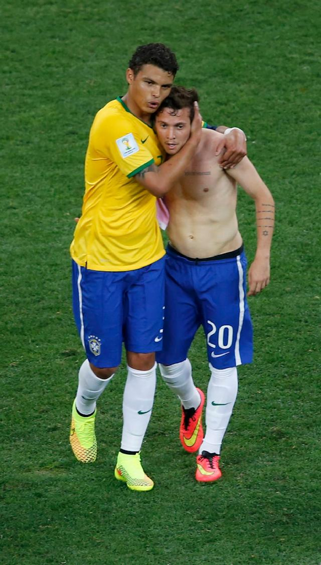 REFILE - CORRECTING ID OF BRAZILIAN PLAYER Brazil's Thiago Silva and Bernard leave the pitch after their 2014 World Cup opening match against Croatia at the Corinthians arena in Sao Paulo June 12, 2014. REUTERS/Paulo Whitaker (BRAZIL - Tags: SOCCER SPORT WORLD CUP)