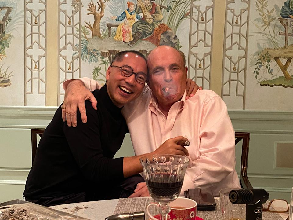 In a photo posted by an obscure Twitter account on Oct. 11, 2020, fugitive Chinese tycoon Guo Wengui and Donald Trump's personal attorney Rudy Giuliani are seen partying together, the same weekend they launched a disinformation campaign to smear Democratic presidential nominee Joe Biden. (Photo: Twitter/@billowypie)