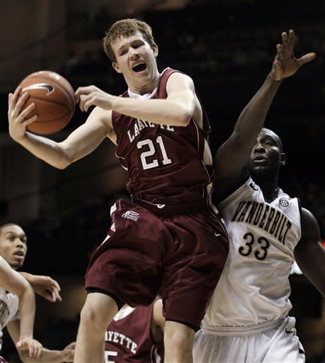 Lafayette guard Jim Mower (21) grabs a rebound in front of Vanderbilt forward Steve Tchiengang (33) in the first half of an NCAA college basketball game Wednesday, Dec. 21, 2011, in Nashville, Tenn. (AP Photo/Mark Humphrey)