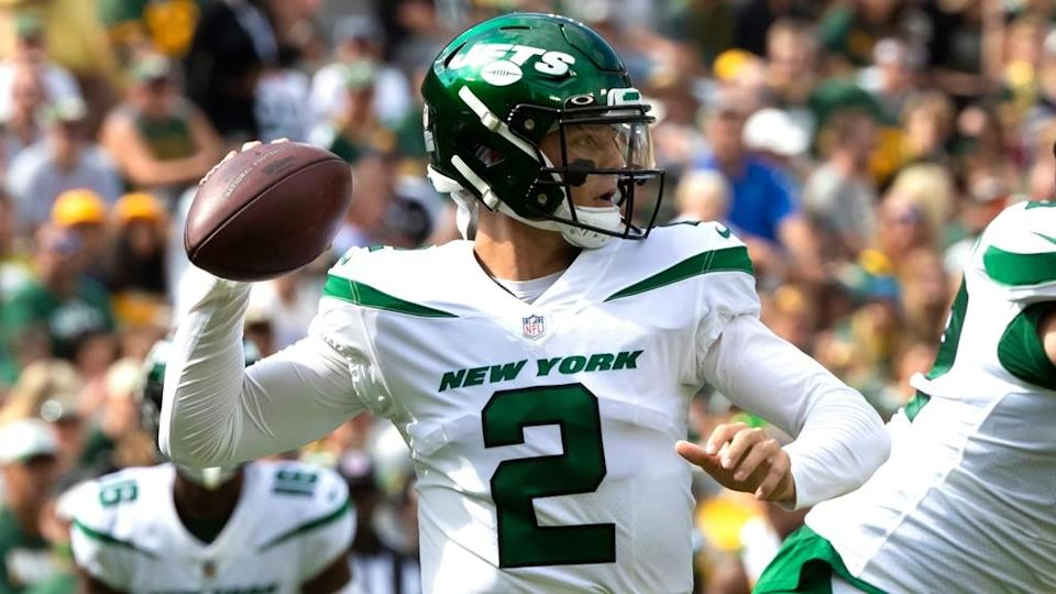 Aug 21, 2021; Green Bay, Wisconsin, USA; New York Jets quarterback Zach Wilson (2) drops back to pass in the first half against Green Bay Packers during a preseason game at Lambeau Field.