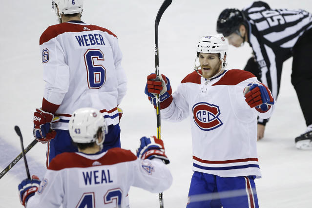 Montreal Canadiens' Jordan Weal (43) and Andrew Shaw (65) celebrate Weal's empty-net goal against the Winnipeg Jets during the third period of an NHL hockey game Saturday, March 30, 2019 in Winnipeg, Manitoba. (John Woods/The Canadian Press via AP)