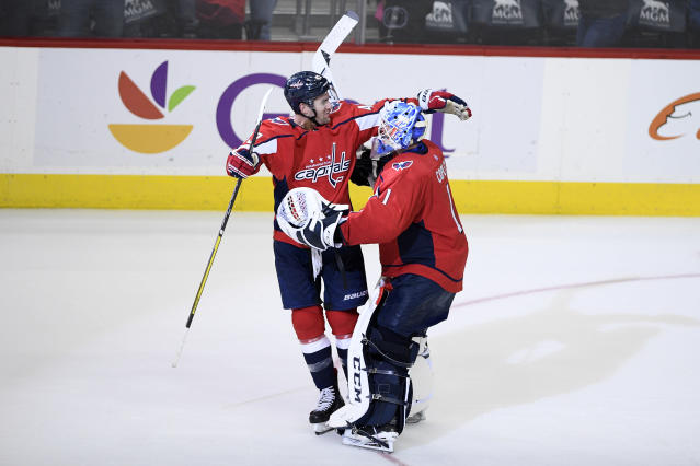 Washington Capitals goaltender Pheonix Copley (1) celebrates with right wing Tom Wilson, left, after an NHL hockey game against the Buffalo Sabres, Saturday, Dec. 15, 2018, in Washington. (AP Photo/Nick Wass)