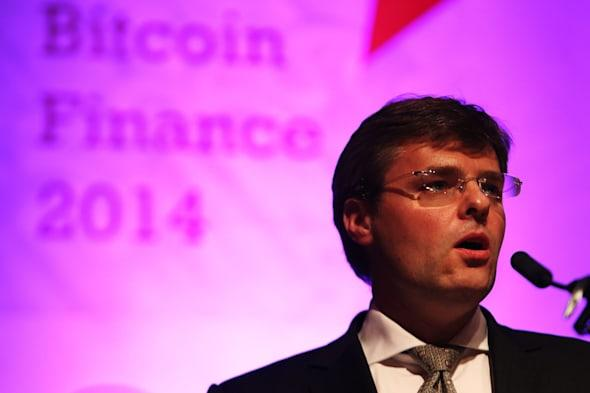 Companies promoting the crypto-currency Bitcoin have been advised to avoid playing cat and mouse with regulators