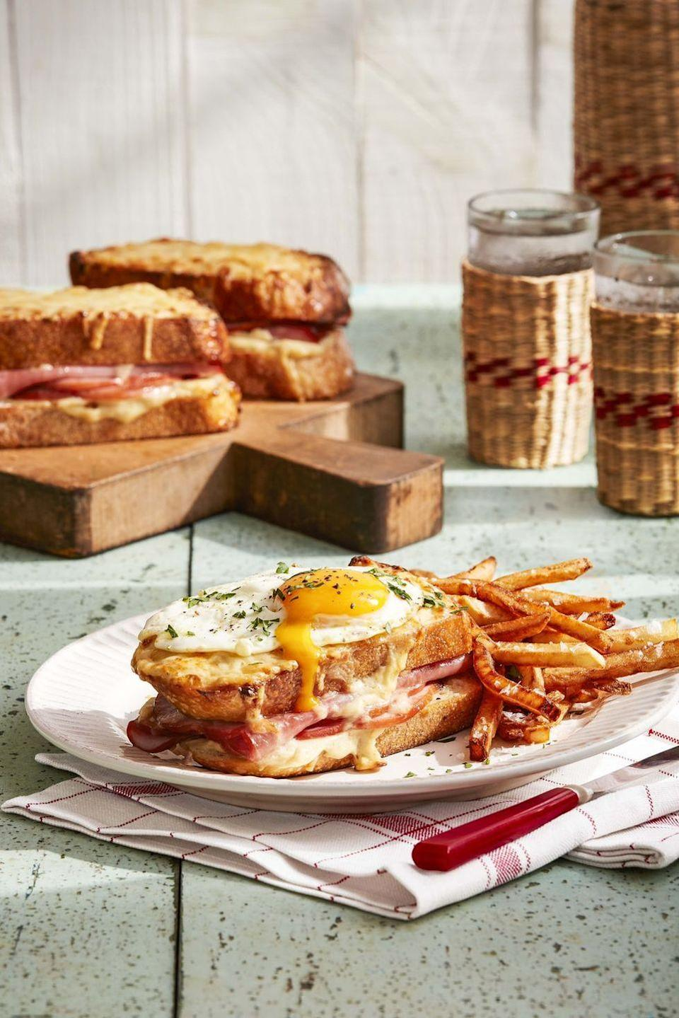 """<p>If you're feeding a more intimate crew and want to get fancy, try this luxe take on a standard ham and cheese. The combo of egg yolk, salty ham, and toasty sourdough is intensely satisfying. <a href=""""https://www.countryliving.com/food-drinks/a32042684/croque-madames/"""" rel=""""nofollow noopener"""" target=""""_blank"""" data-ylk=""""slk:"""" class=""""link rapid-noclick-resp""""><strong><br></strong></a></p><p><strong><a href=""""https://www.countryliving.com/food-drinks/a32042684/croque-madames/"""" rel=""""nofollow noopener"""" target=""""_blank"""" data-ylk=""""slk:Get the recipe"""" class=""""link rapid-noclick-resp"""">Get the recipe</a>.</strong> </p>"""