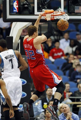 Los Angeles Clippers power forward Blake Griffin (32) dunks the ball against the Minnesota Timberwolves during the first quarter of an NBA basketball game, Thursday, April 12, 2012, in Minneapolis. (AP Photo/Genevieve Ross)
