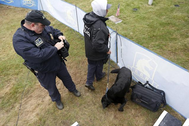 An ATF canine unit inspects a bag near the Boston Marathon start line in Hopkinton, Massachusetts, April 20, 2015. A field of 30,000 runners is set to line up for the 119th running of the world's oldest annual marathon. REUTERS/Dominick Reuter