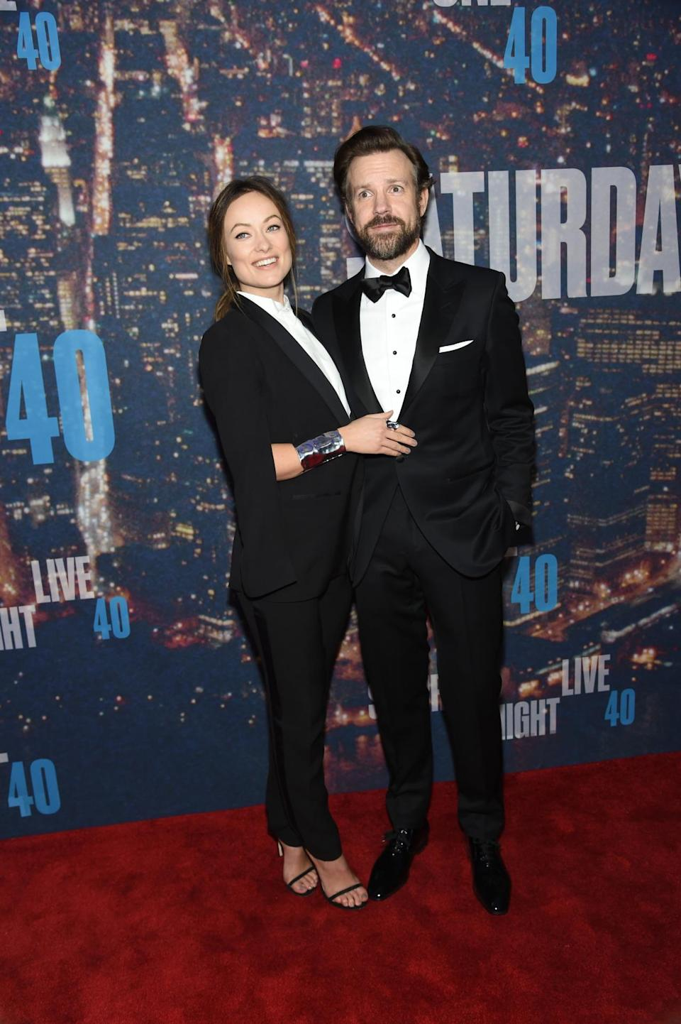 Olivia Wilde, wearing an H&M Conscious Commerce Collection suit, matches her husband, Jason Sudeikis. The couple that dresses together, stays together…