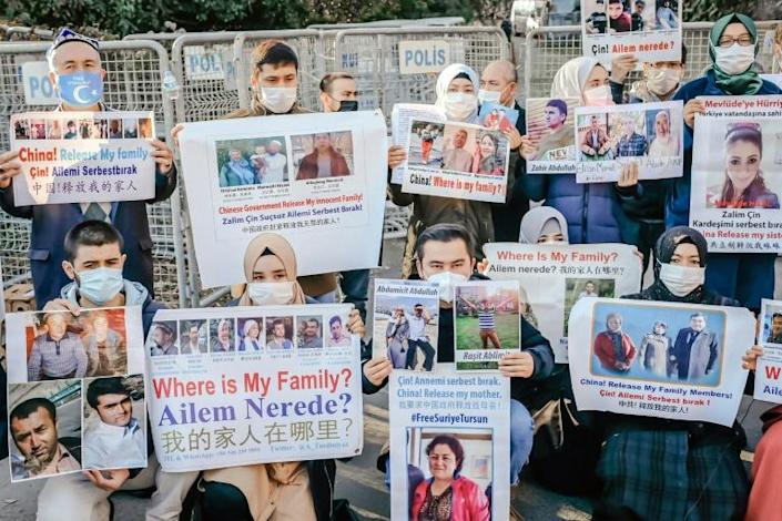 Members of the Muslim Uighur community hold placards as they demonstrate in December 2020 in front of the Chinese consulate in Istanbul, which has become a major center for Uighur exiles
