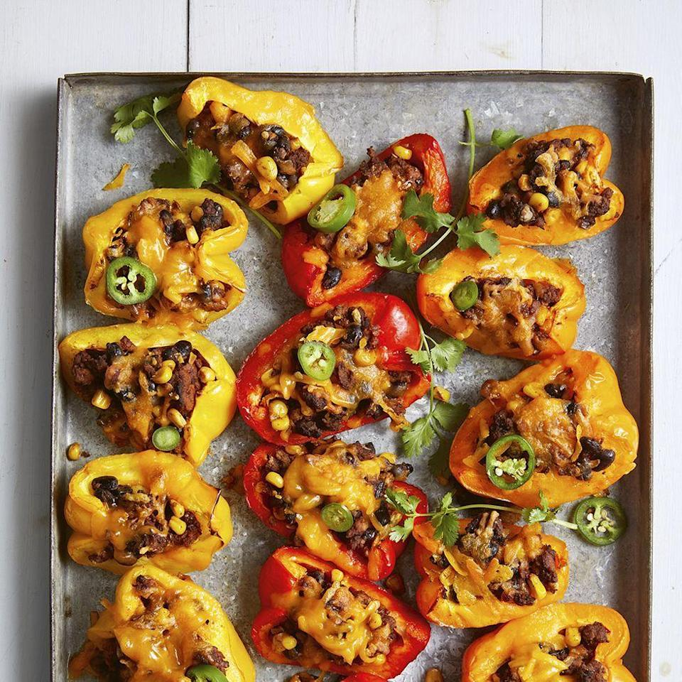 """<p>Looking for a healthy Super Bowl snack? Swap chips for crunchy bell peppers — you'll get an extra boost of vitamin C!</p><p><em><a href=""""https://www.womansday.com/food-recipes/a34145180/bell-pepper-nachos-recipe/"""" rel=""""nofollow noopener"""" target=""""_blank"""" data-ylk=""""slk:Get the recipe from Woman's Day »"""" class=""""link rapid-noclick-resp"""">Get the recipe from Woman's Day »</a></em></p>"""
