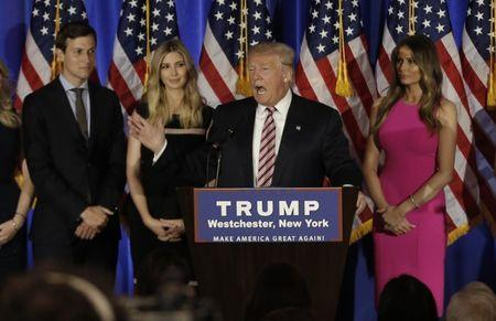 Republican U.S. presidential candidate Donald Trump speaks as his son-in-law Jared Kushner (L), daughter Ivanka (2nd from L) and his wife Melania (R) listen at a campaign event on the day that several states held presidential primary elections, including California, at the Trump National Golf Club Westchester in Briarcliff Manor, New York, U.S., June 7, 2016. REUTERS/Mike Segar