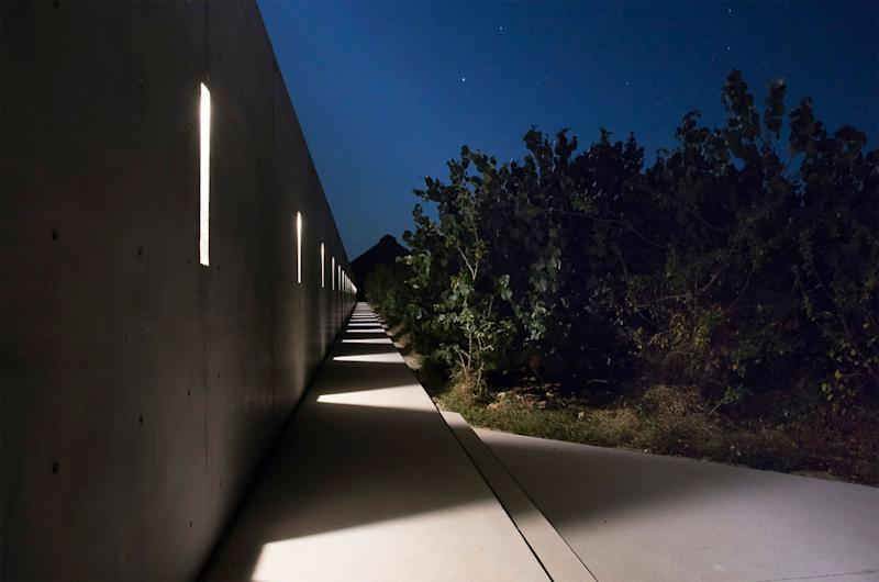 Casa Wabi at night. This is the long outdoor corridor that spans 10,024 feet (312 meters).