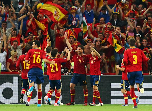 DONETSK, UKRAINE - JUNE 23: Xabi Alonso of Spain celebrates after scoring the first goal with team mates during the UEFA EURO 2012 quarter final match between Spain and France at Donbass Arena on June 23, 2012 in Donetsk, Ukraine. (Photo by Martin Rose/Getty Images)